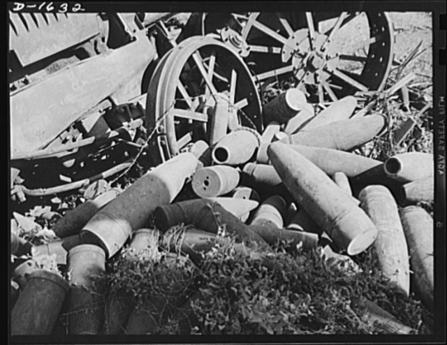 Weapons from waste. This is where they come in. These old shells rested for years, along with thousands of other discarded articles, in a junkyard, but now they'll be given another chance to serve their country. Junk today, they'll be melted down to provide the streamlined armament of tomorrow