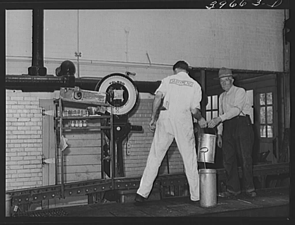 Weighing cans of cream at the Dairymen's Cooperative Creamery. Caldwell, Canyon County, Idaho