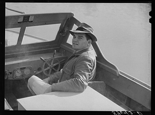 Weldon P. Smith, FSA (Farm Security Administration) supervisor, going out in the bayous and marshes to visit some of the muskrat trappers and marshes. Near Delacroix, Island, Louisiana. See general caption number one