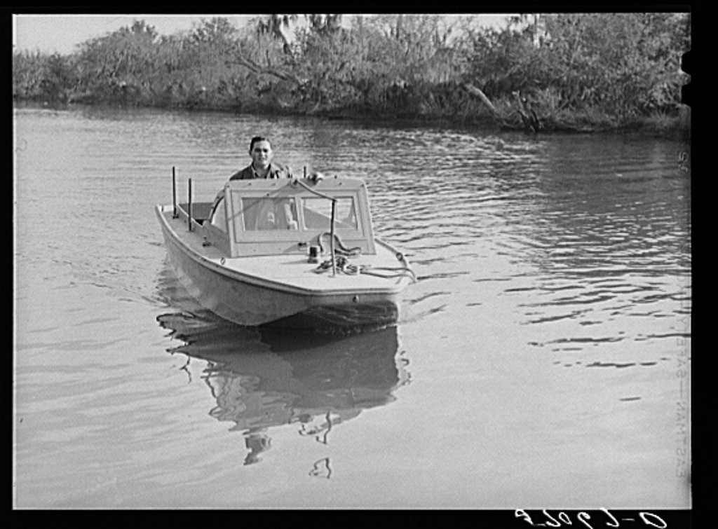 Weldon P. Smith, FSA (Farm Security Administration) supervisor, going out to the bayous and marshes to visit some of the muskrat trappers at their camps. Near Delacroix Island, Louisiana. See general caption number one