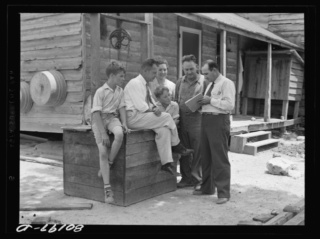 Well engineer and county supervisor talking over home plan. Charles County, Maryland
