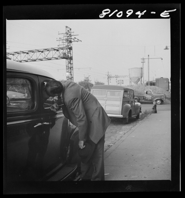 Westport, Connecticut. Commuter kissing his wife before catching train for New York
