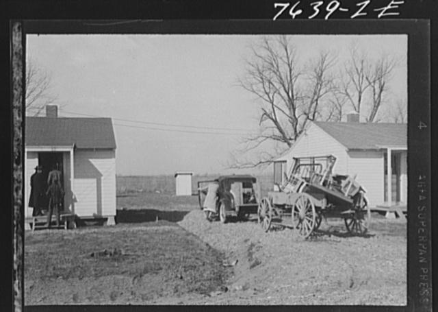 Wicker family preparing to unload household furniture. Southeast Missouri