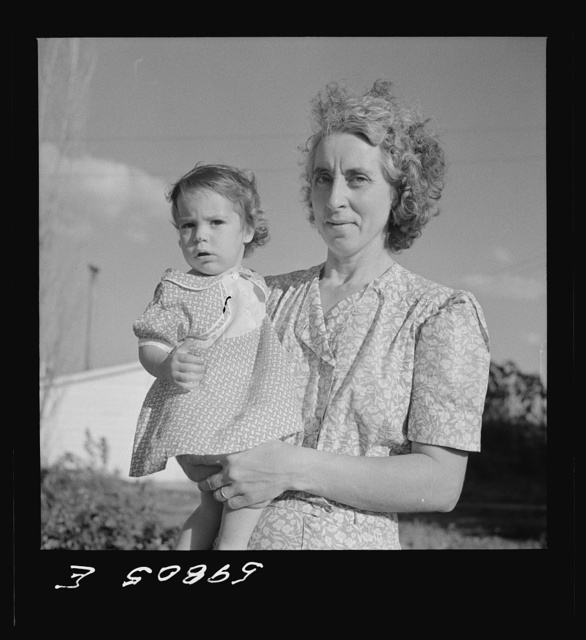 Wife and child of one of the members of the Two Rivers Cooperative Company, FSA (Farm Security Administration) project, with a neighbor at Waterloo, Nebraska