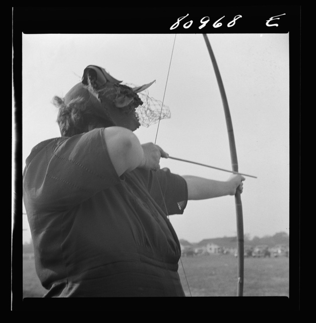 Windsor Locks, Connecticut. A visitor learning to shoot bows and arrows at five shots for a nickel at the Indian fair sponsored by the local Indian association