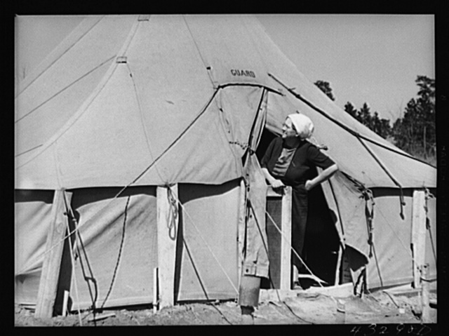 Woman living in a tent in a settlement for workers at Fort Bragg, near Fayetteville, North Carolina