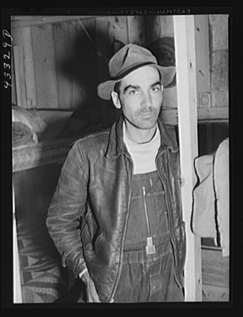 Worker employed at Fort Bragg and renting a lower berth in a bunkhouse recently constructed behind a filling station. Near Silver Lake, North Carolina