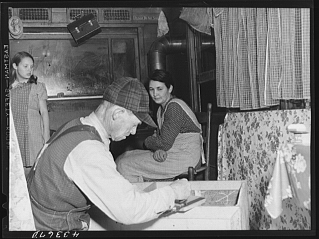 """Worker from Fort Bragg and his family living in an old streetcar. He is building for their """"new home."""" Came a hundred miles for this job and expect to move on soon. Near Manchester, North Carolina"""