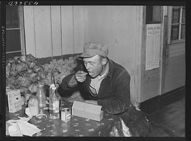 Worker from Fort Bragg having his dinner at a crossroads store in Manchester, North Carolina