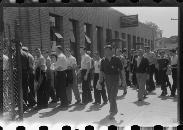 Workers entering plant at afternoon change of shift. Pratt and Whitney plant, United Aircraft, East Hartford, Connecticut