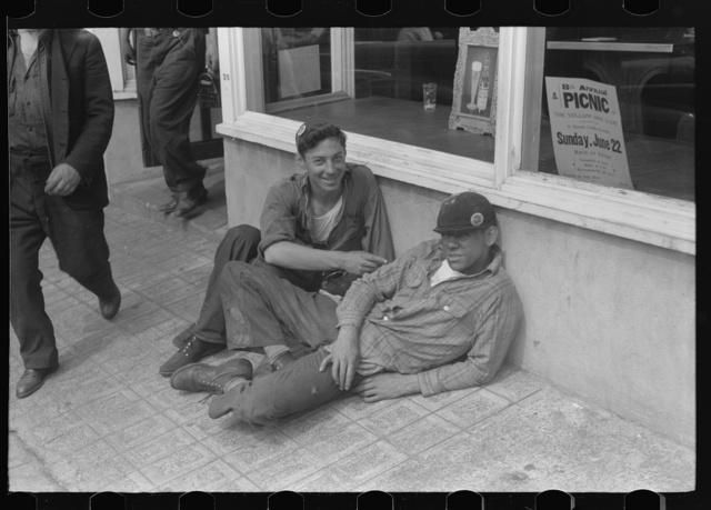 Workers lounging around town and waiting for a lift home at afternoon change of shift of Electric Boat Works, Groton, Connecticut