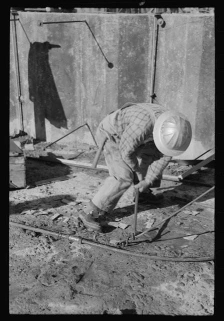Workman at Shasta Dam, Shasta County, California