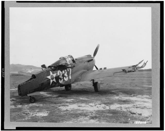 [Wrecked P-40 airplane, at Bellows Field, machine-gunned on the ground, during the bombing of Hickam Field, Hawaii]