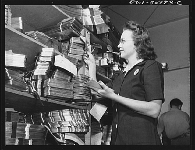 A clerk in the hydropress department checks parts as they come into the department