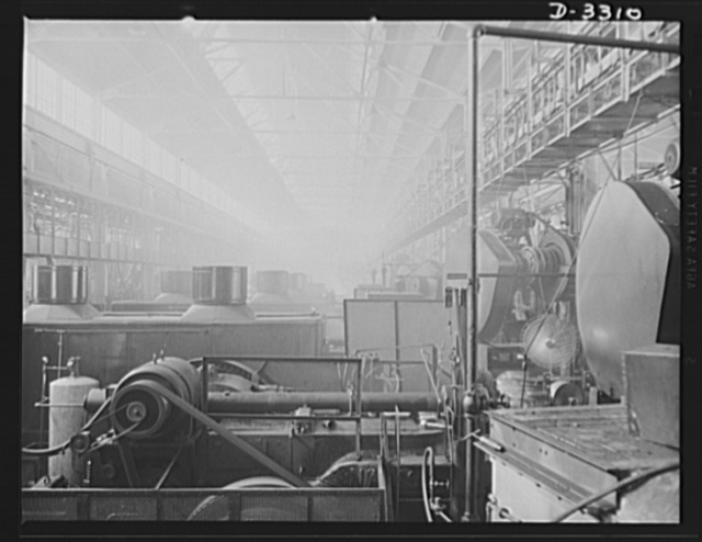 A line of forges that seem endless is turning out a stream of shells that is endless. The auto manufacturing plant that used these same forges for car parts is now on a full wartime production basis. Oldsmobile, Lansing, Michigan