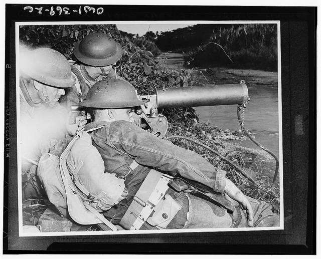 A machine gun crew of American troops in the British West Indies guarding a strategic point along a river during the course of maneuvers