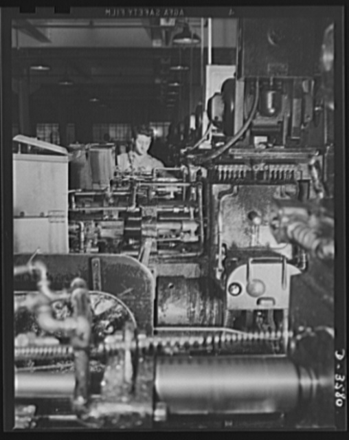A multiple spindle screw machine on 20mm fuse production in a plant that formerly made cash registers. National Cash Register Company, Dayton, Ohio