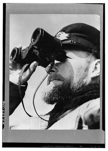 A portrait of a typical officer of the British Royal Navy who has been at sea since leaving school. He was photographed aboard an ex-American destroyer, part of a convoy escort across the Atlantic protecting cargo ships laden with planes, food, and other supplies