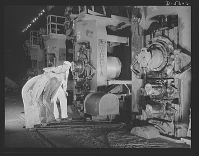 A poster comes to life. It takes a heap o' treatin' to make a ship's hull out of scrap metal. Soldier, welder and sailor watch this giant four-high machine at Allegheny-Ludlum which rolls bloomed ingots into sheet steel. Thanks to welder George Woolslayer's explanations of the steel-making process, Sergeant Vineyard and Chief Evans are getting a liberal education in the fine art of production for war. Allegheny-Steel, Pittsburgh