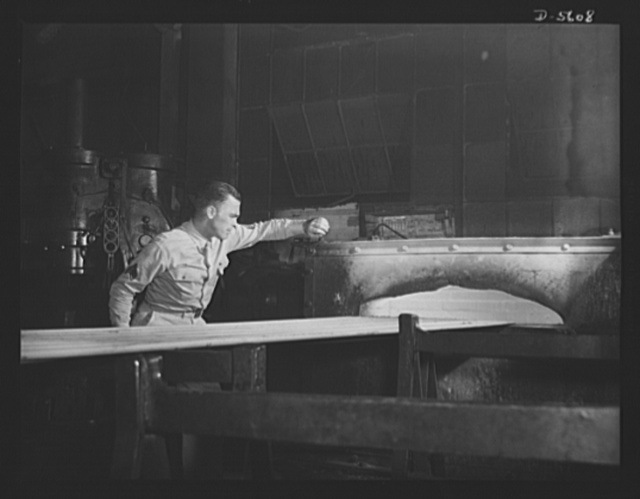 """A poster comes to life. Picture of a soldier learning something about his gun. Sergeant French L. Vineyard, on furlough to meet his comrades of the """"Men Working Together"""" poster, watches the heat treatment of steel tubing at an Allegheny-Ludlum mill. He's always though that gun of his """"just growed--like Topsy."""" Now his hat is off to the skilled workers and intricate machines whose roles in the winning of this war are as vital as his own. Allegheny-Steel, Pittsburgh"""