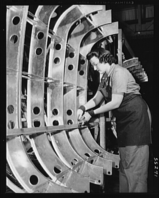 A woman employee assembles a B-25 tank on a jig at North American Aviation
