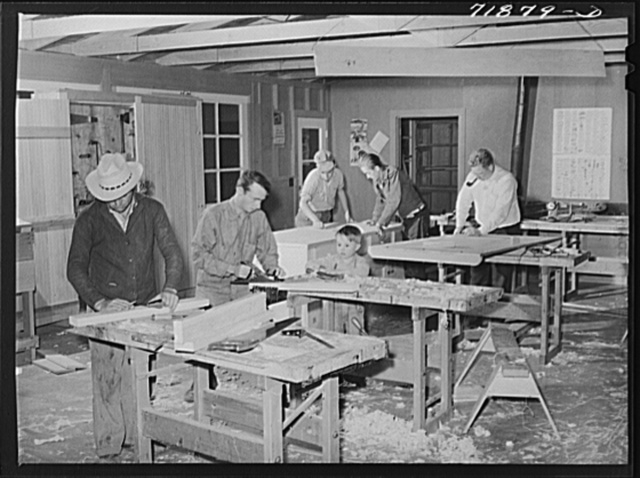 Agricultural workers in the workshop at the FSA (Farm Security Administration) farm workers' community at Eleven Mile Corner, Arizona