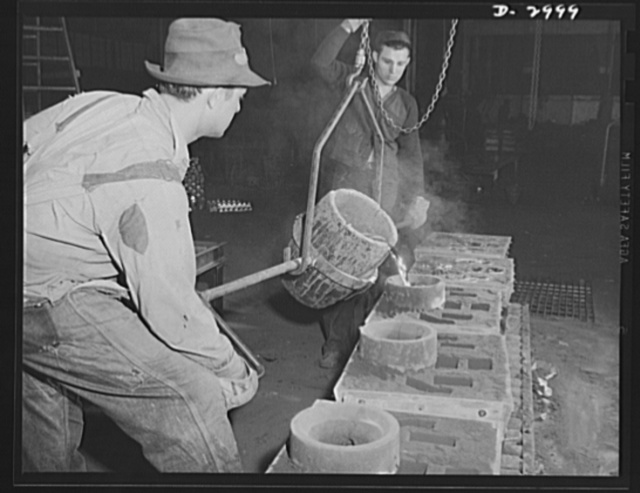 Aluminum casting. Experienced workers in an aluminum plant, converted to production of essential articles for America's armed forces, pictured pouring the molten aluminum alloy into molds. Aluminum Industries Inc., Cincinnati, Ohio