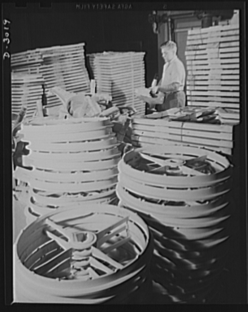 Aluminum casting. Stock room in the shipping department of a large Midwest aluminum factory. Completed rings may be destined for use by Uncle Sam's armed forces--somewhere in the field. Exact use and destination of these articles has been kept secret. Aluminum Industries Inc., Cincinnati, Ohio
