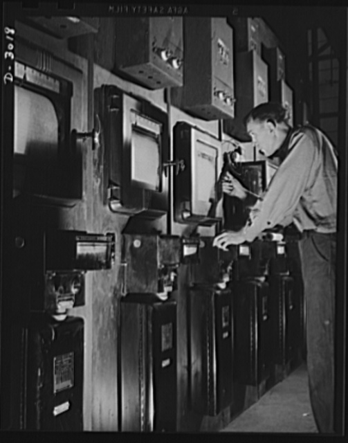 Aluminum casting. To make certain that aluminum is being treated in exact accordance with specifications, this worker sets instruments to the correct temperature on heat treating controls of unit. Aluminum Industries Inc., Cincinnati, Ohio