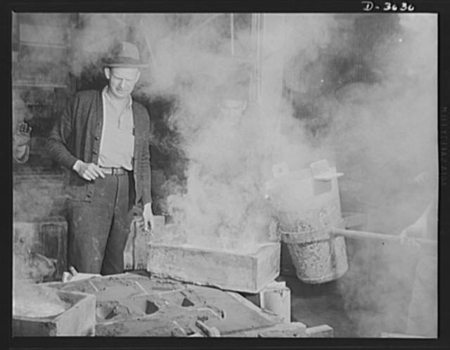 Aluminum casting. Uncle Sam's soldiers on the production lines of defense pour a large magnesium casting. The molten alloy enters the runner box first. Magnesium is one of the most valuable metals for war production. Exact purpose of this casting is kept secret. Aluminum Industries Inc., Cincinnati, Ohio