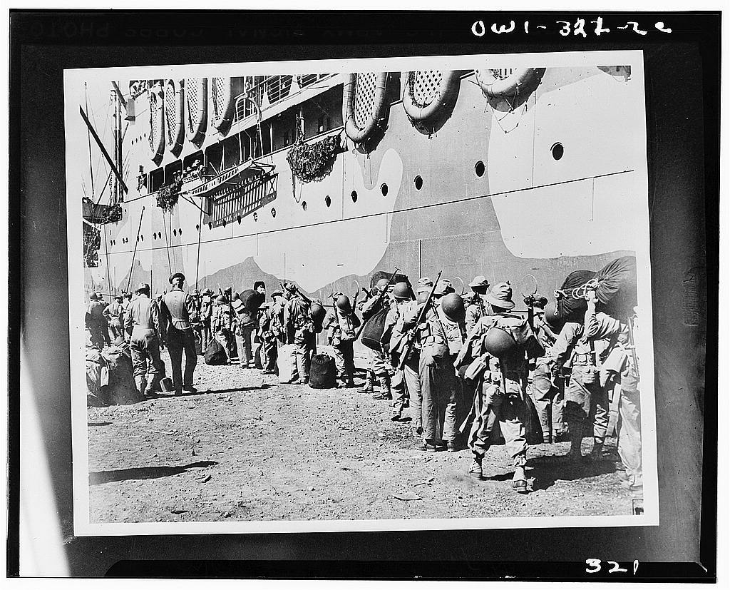 American troops boarding a transport which will take them from New Caledonia to the Solomon Islands battlefront