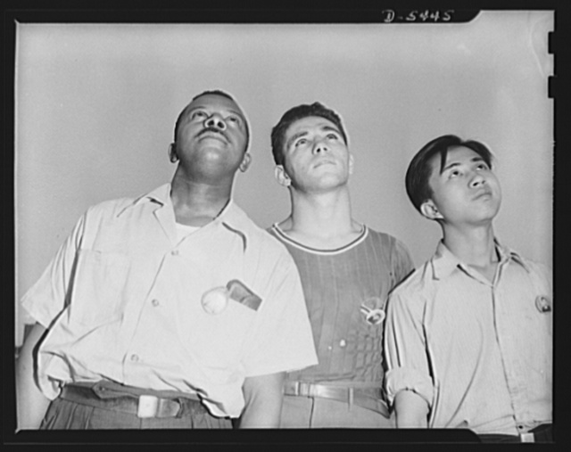 "Americans all. ""She's a beautiful ship,"" and it took the combined efforts of these three Americans to help build her. Marcell Webb, Negro; Henry Bennett; and Phillip Leung, Chinese, watch the test flight of a P-47 pursuit ship they helped build. Republic Aircraft Corporation"