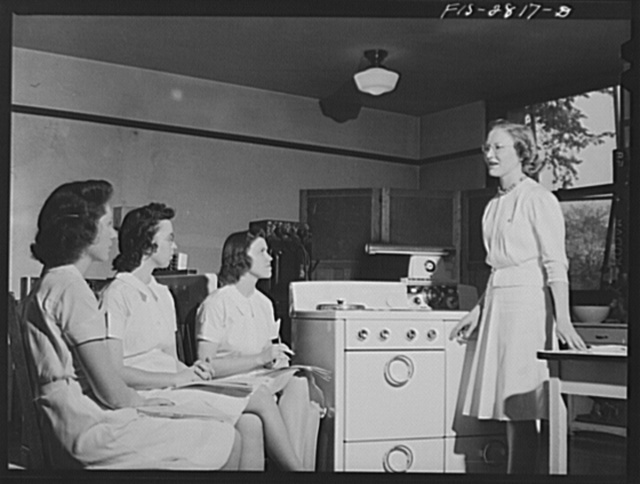 An advanced class in household equipment at Iowa State College. Ames, Iowa