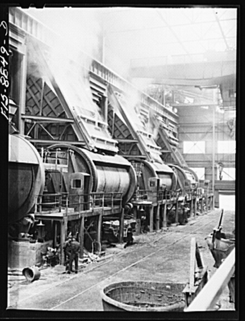 Anaconda smelter, Montana. Anaconda Copper Mining Company. Batteries of converters. Degree of processing in the converters is determined by the color of the smoke