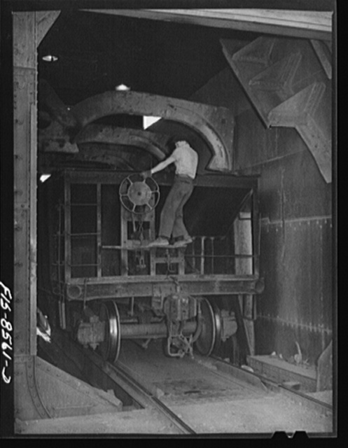 Anaconda smelter, Montana. Anaconda Copper Mining Company. Brakeman setting the brakes on an ore car in the unloading mechanism which will dump the ore into a 200 ton hopper