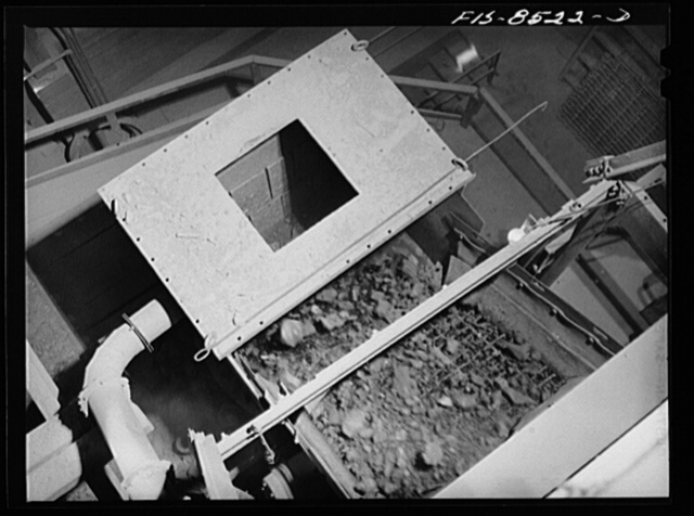 Anaconda smelter, Montana. Anaconda Copper Mining Company. Copper ore going through the Symons crusher; this is an intermediate step between the gyratory crusher and the ore bins