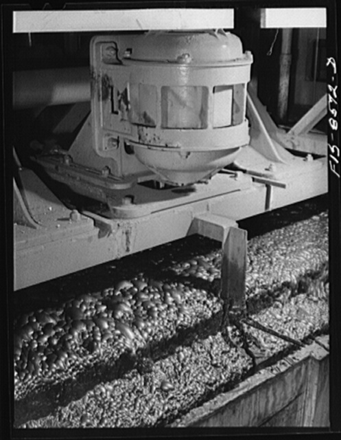 Anaconda smelter, Montana. Anaconda Copper Mining Company. Flotation machine in which particles of copper sulphide ore are attracted to the oily bubbles which retain the minerals by the process of adsorption; the ore floats and is skimmed off from the gangue, which remains submerged and it (the gangue) is waste material