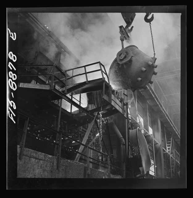 Anaconda smelter, Montana. Anaconda Copper Mining Company. Returning the first slag from the converter to the reverberatory furnace. The first few ladles of slag always contain some copper, and to redeem this copper the slag is returned to the furnace