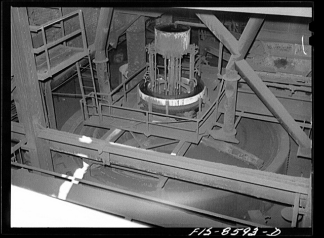 Anaconda smelter, Montana. Anaconda Copper Mining Company. Top of one of the multiple-hearth roasting furnaces. The concentrates move by gravity from one hearth to another; in one hearth the material is moved from circumference to center and on the next hearth vice versa