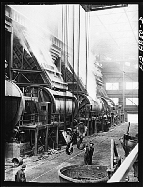Anaconda smelter, Montana. Anaconda Copper Mining Compnay. Batteries of converters. Degree of processing in the converters is determined by the color of the smoke