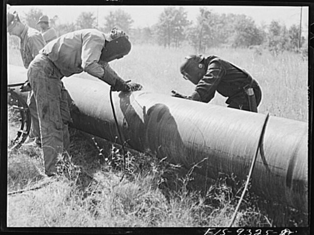 Arkansas-Texas state line to Gurdon, Arkansas. War emergency pipeline from Longview, Texas to Norris City, Illinois. Electric welders at work