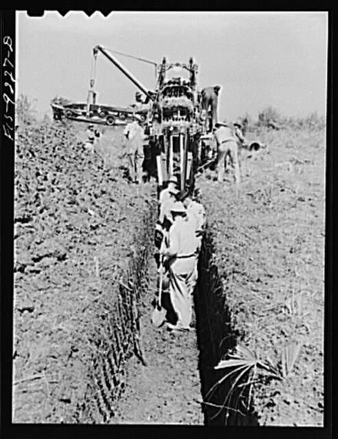 Arkansas-Texas state line to Gurdon, Arkansas War emergency pipeline from Longview, Texas to Norris City, Illinois. A trench-digging machine