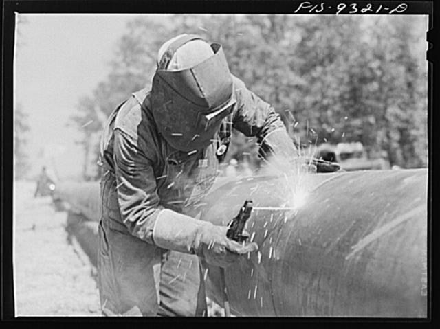 Arkansas-Texas state line to Gurdon, Arkansas. War emergency pipeline from Longview, Texas to Norris City, Illinois. Welder at work