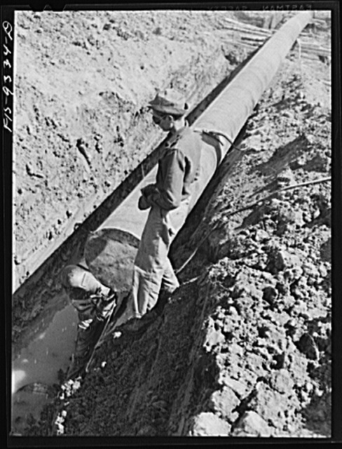 Arkansas-Texas state line to Gurdon, Arkansas. War emergency pipeline from Longview, Texas to Norris City, Illinois.  Tackwelding metal cover over end of pipe