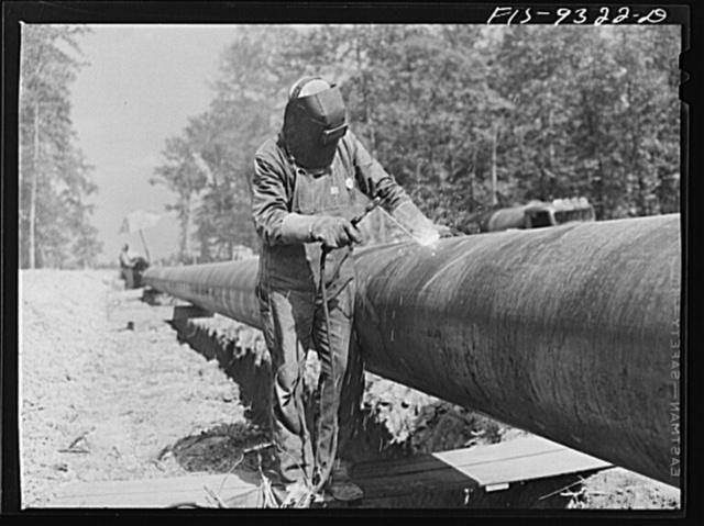 Arkansas-Texas state line to Gurdon, Arkansas. War emergency pipeline from Longview, Texas to Norris City, Illinois. Electric welder at work