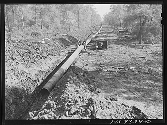 Arkansas-Texas state line to Gurdon, Arkansas. War emergency pipeline from Longview, Texas to Norris City, Illinois. Right-of-way of war emergency pipeline running through wooded land