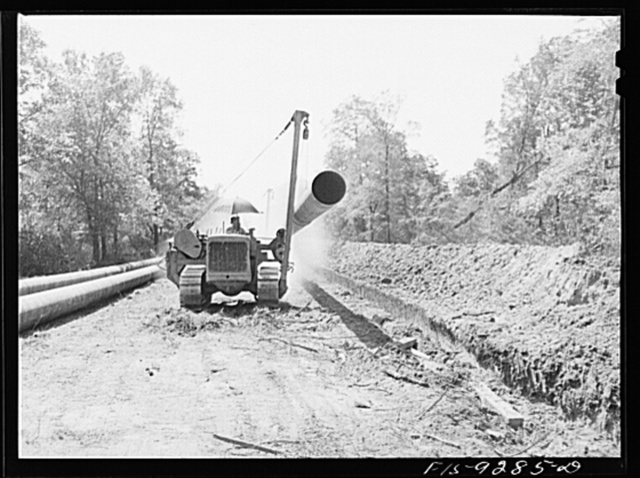 Arkansas-Texas state line to Gurdon, Arkansas. War emergency pipeline from Longview, Texas to Norris City, Illinois. Bringing a forty-foot section to the main line in stove pipe method of welding