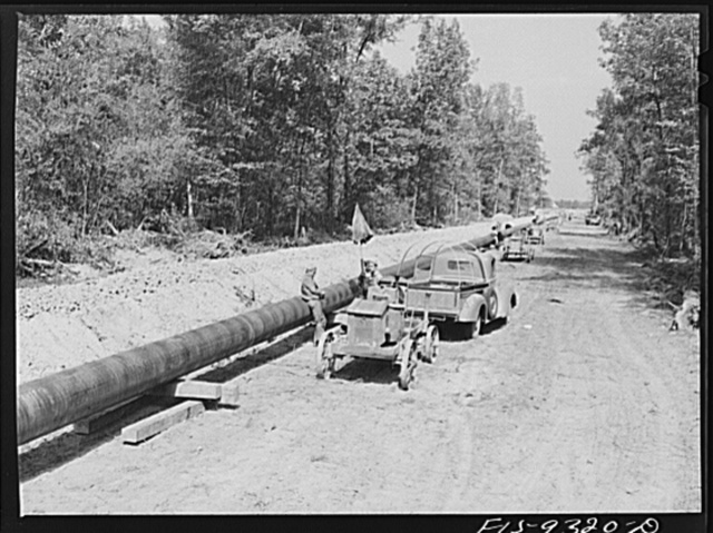 Arkansas-Texas state line to Gurdon, Arkansas. War emergency pipeline from Longview, Texas to Norris City, Illinois. Firing line of welders at work on the pipeline. Electricity is furnished by gasoline driven generators