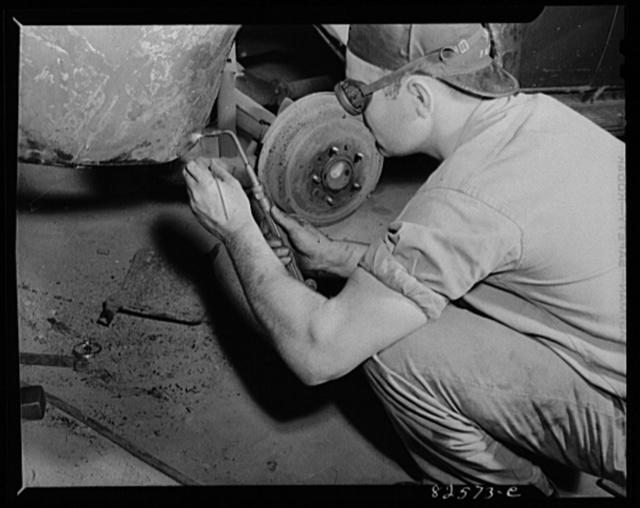 Arlington, Virginia. Auto body work plant. Welding a torn fender