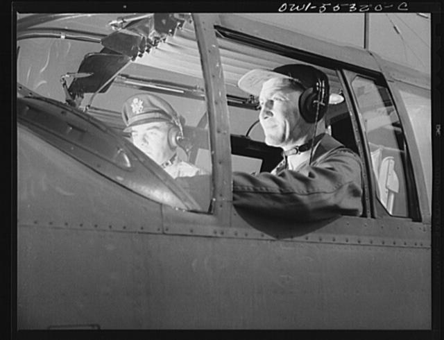 Army Air Force test pilots prepare to make a routine test flight in a North American B-25 bomber prior to acceptance by the Army